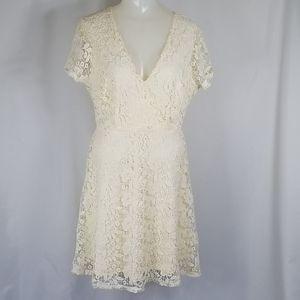 Ivory lace, cap sleeve, surplice V-neck dress